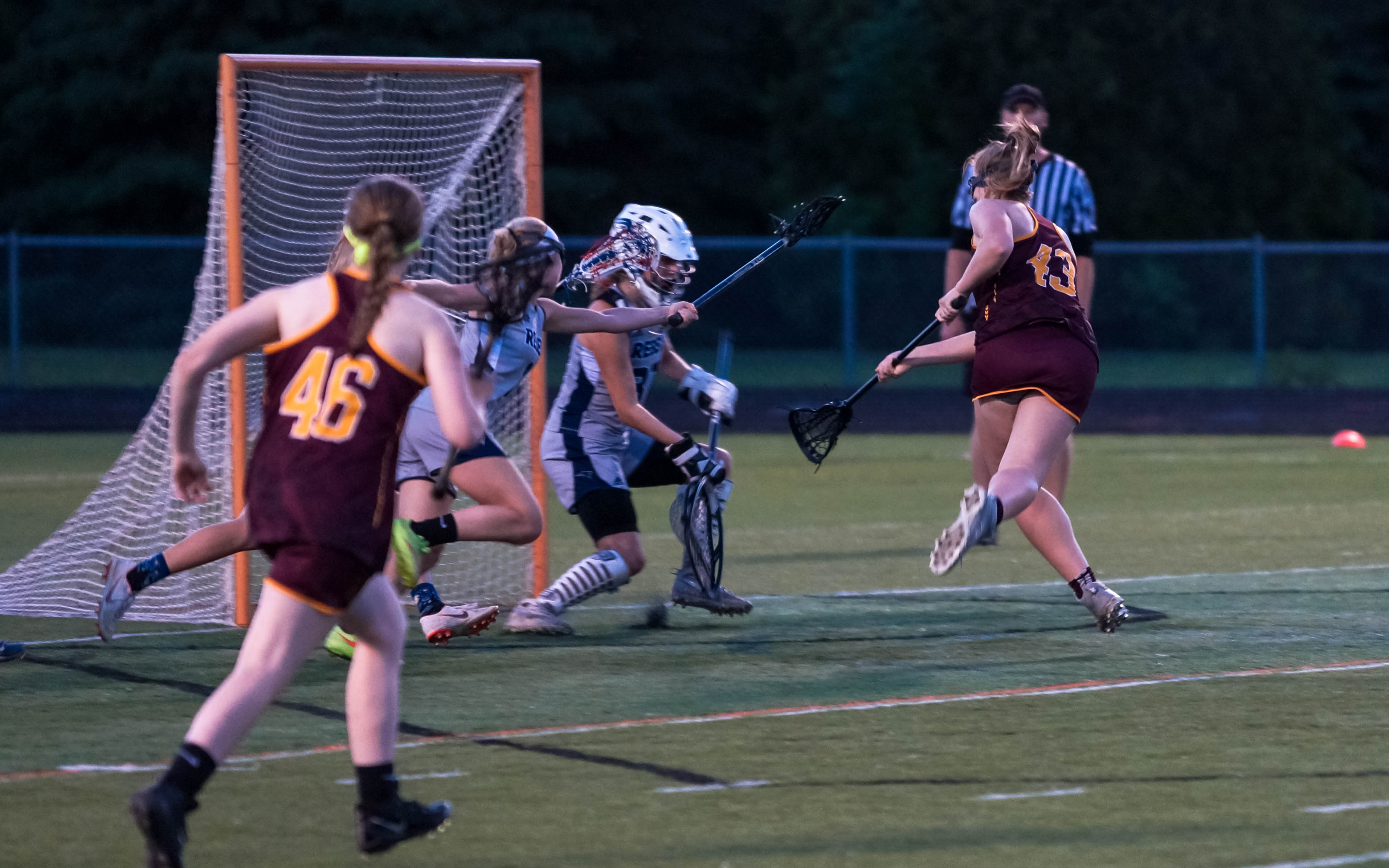 Forest Lake's Mikaela Ness (43) netted the game-winning goal just 17 seconds into overtime to send the Rangers to the state tournament. Forest Lake defeated Champlin Park 7-6 at Osseo High School on Wednesday. Photo by Korey McDermott, SportsEngine
