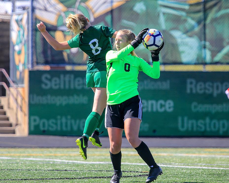 St. Michael-Albertville goalkeeper Meriel Orham (0) made a save in front of Edina's Gwen Hendrickson (8) in the second half.  Photo by Mark Hvidsten, SportsEngine