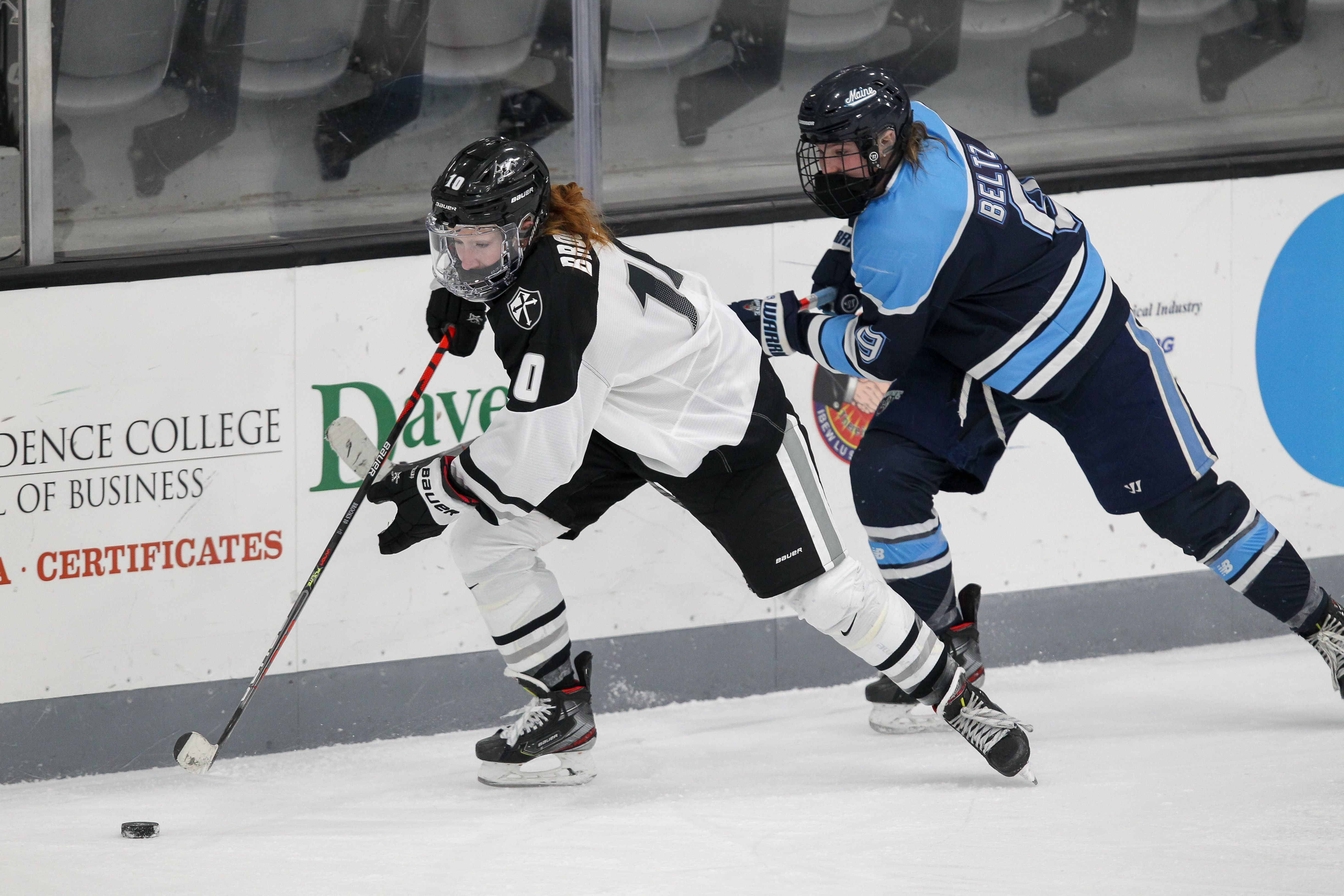 KC Brooks (left) experienced a special season for Providence women's hockey. The Friars appeared in their first Hockey East final since 2012 and received their first NCAA tournament bid in more than 15 years. Photo courtesy of Providence College Athletics