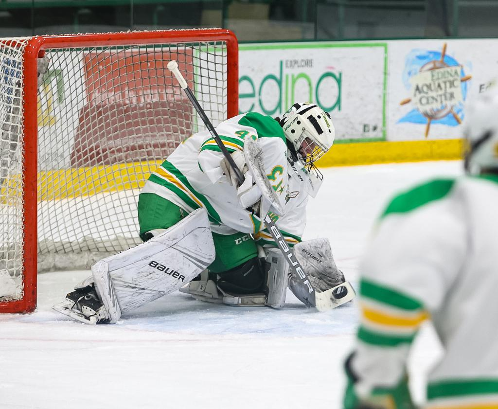 Sophomore Uma Corniea makes a save in the first period.  The Princeton commit tallied 21 saves on Thursday night. Photo by Cheryl A. Myers, SportsEngine