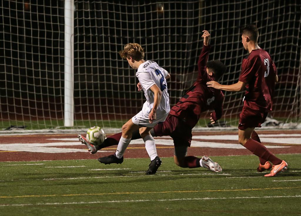Angel Mendez-Lopez (4) deflects the ball away from Ben Frommelt (2) stopping a scoring chance in the second half.  Richfield defeated Holy Angels 1-0 at Richfield High School on Tuesday night. Photo by Cheryl A. Myers, SportsEngine