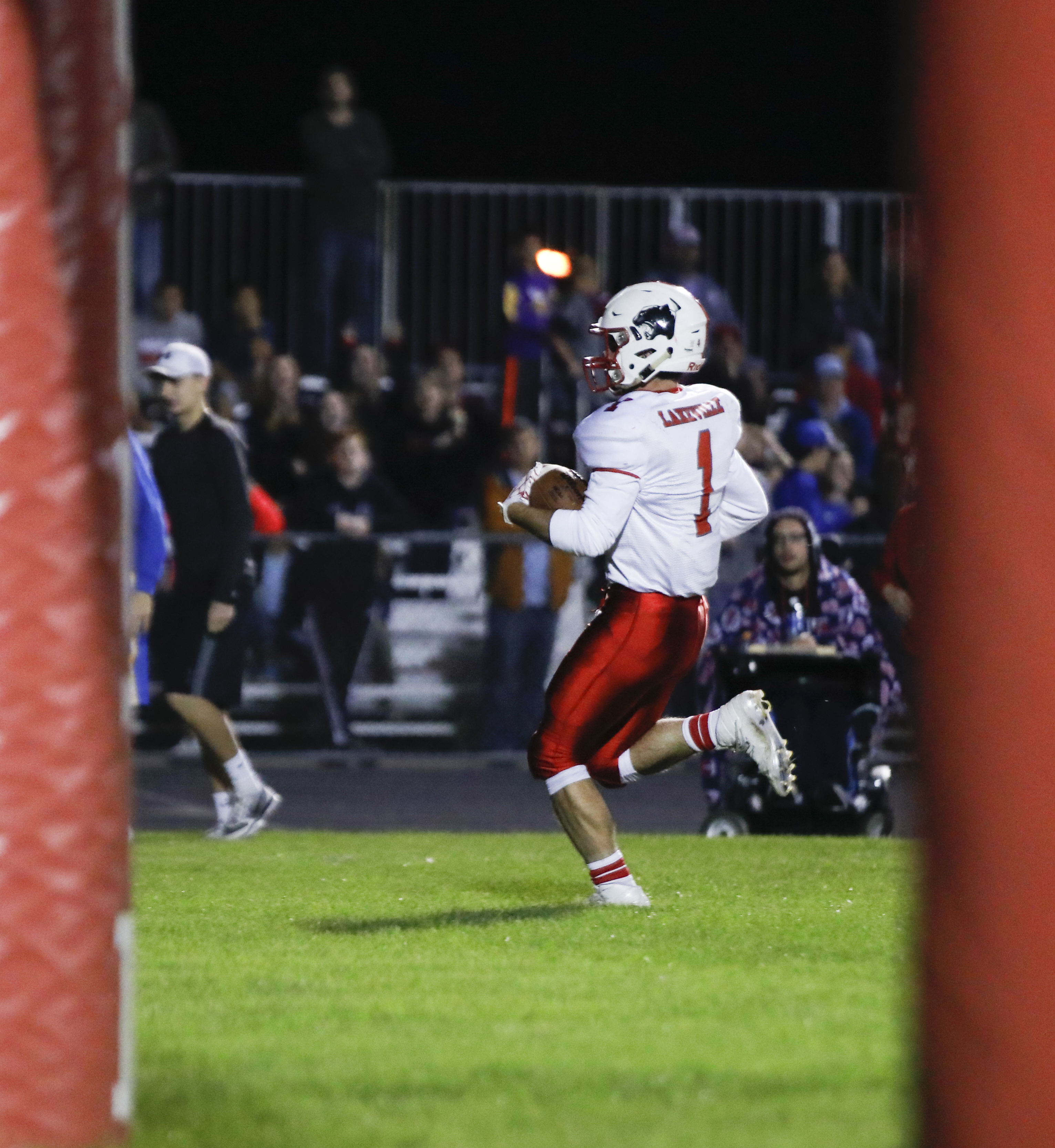 Ryan Dalrymple (1) of Lakeville North runs the ball in to score a touchdown helping his teal defeat rival Lakeville South 35-0 away. Photo by Chris Juhn