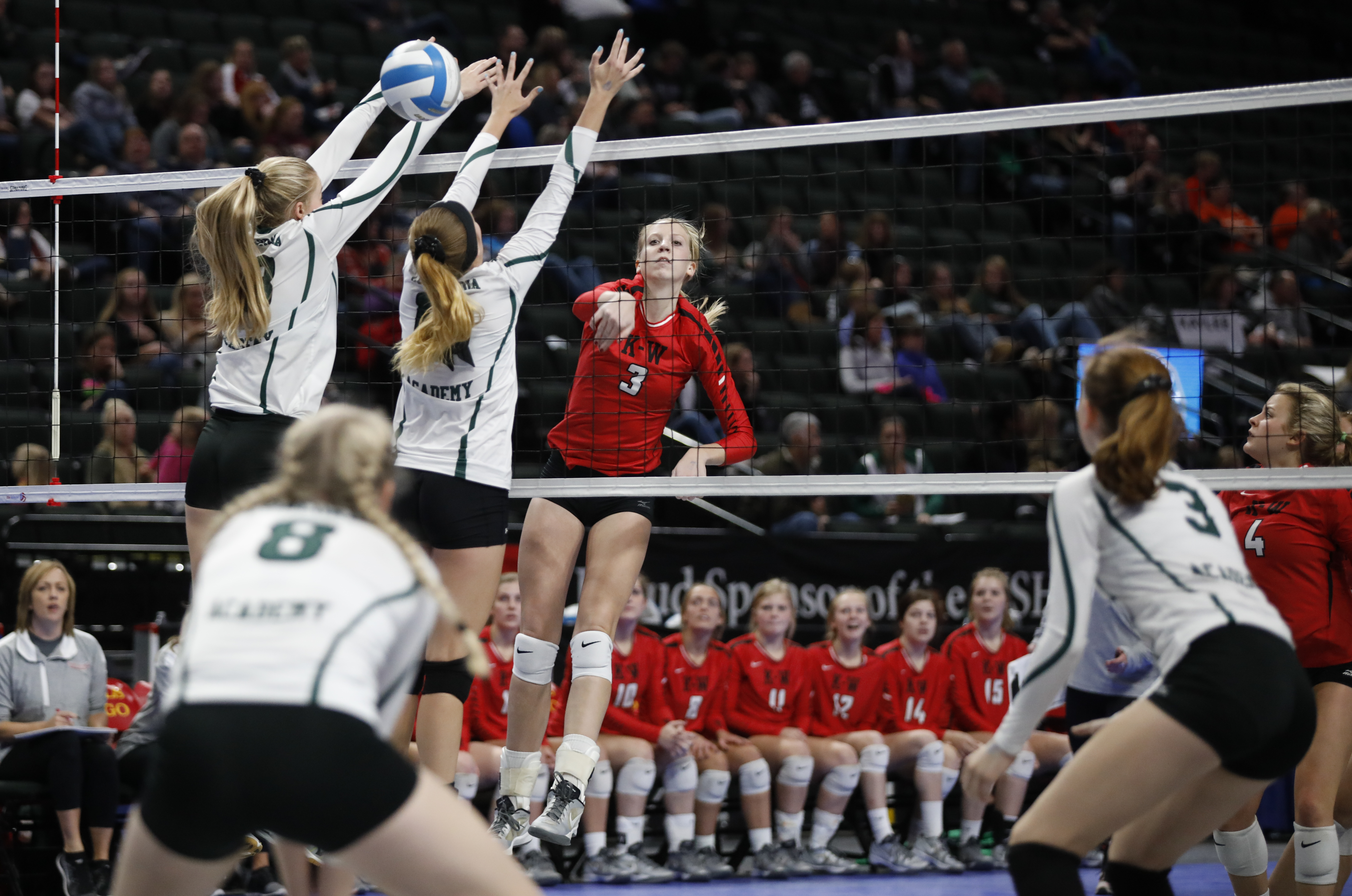 Megan Flom (3) of Keneon-Wanamingo hits the ball into Concordia territory. Concordia upset Kenyon-Wanamingo in the 2A semi-finals at the Xcel Energy Center and will advance in the state tournament. Photo by Chris Juhn