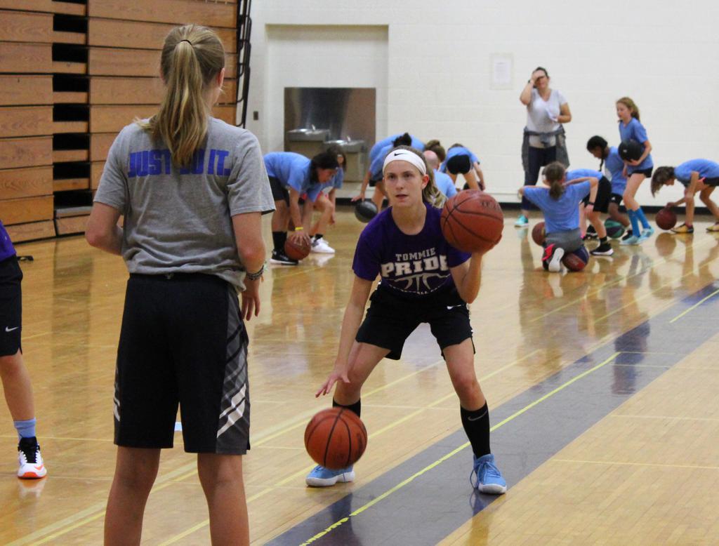 8th grade girls performing ball handling and dribbling drills