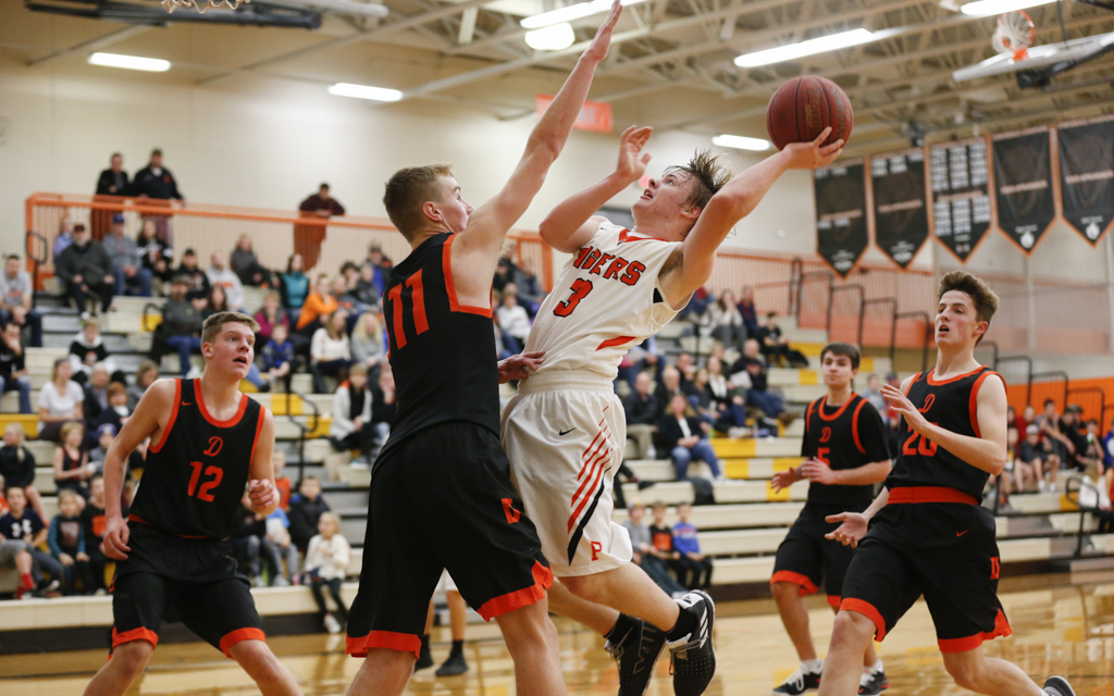 Princeton's James Flicek  drives for a layup against Delano Tuesday night. Flicek had 18 points in the Tigers' 76-61 victory over the Tigers. Photo by Jeff Lawler, SportsEngine