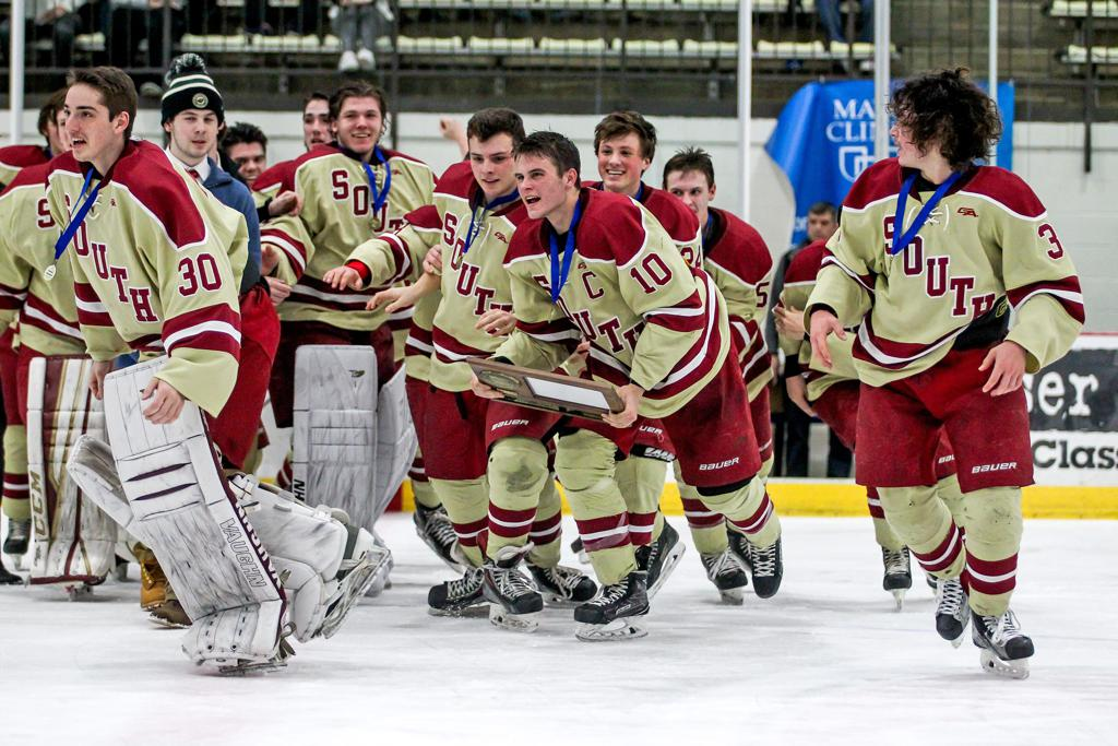 Lakeville South seniors Joshua Ess (10) and Bradley Golant (3) lead the charge to celebrate the Class 2A Section 1 championship after a 3-1 victory over Lakeville North. Photo by Mark Hvidsten, SportsEngine