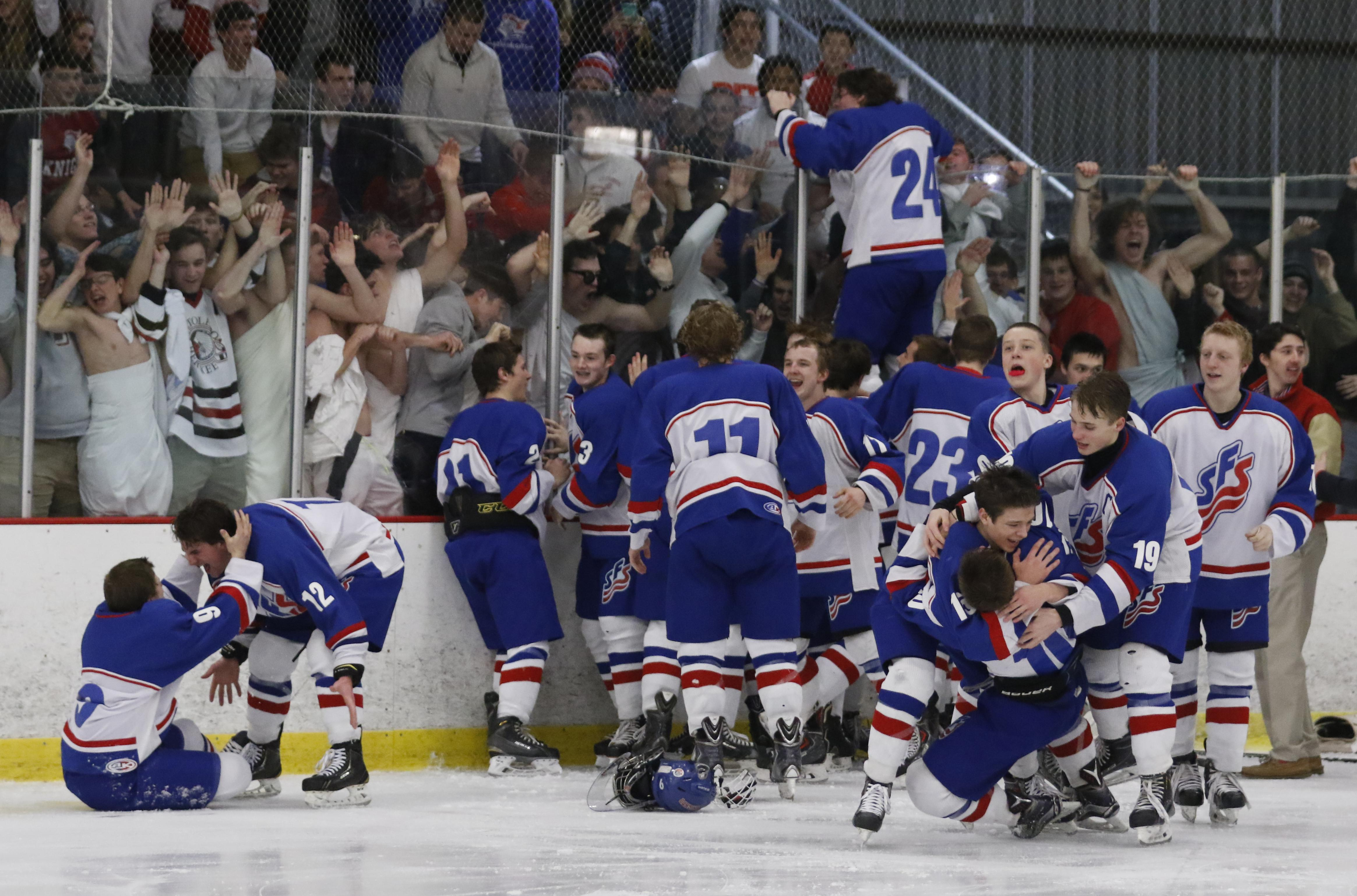 St. Francis players celebrate after defeating Bowling Green. THE BLADE/ANDY MORRISON