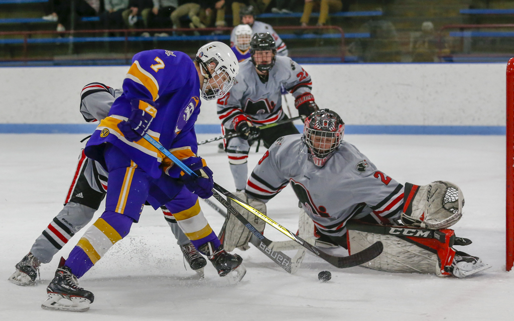Lakeville North goalie Caleb Mayer stretches out to make a pad save on Cloquet's Christian Galatz. Meyer made 24 saves in the Panthers' 3-2 overtime victory over the Lumberjacks. Photo by Jeff Lawler, SportsEngine