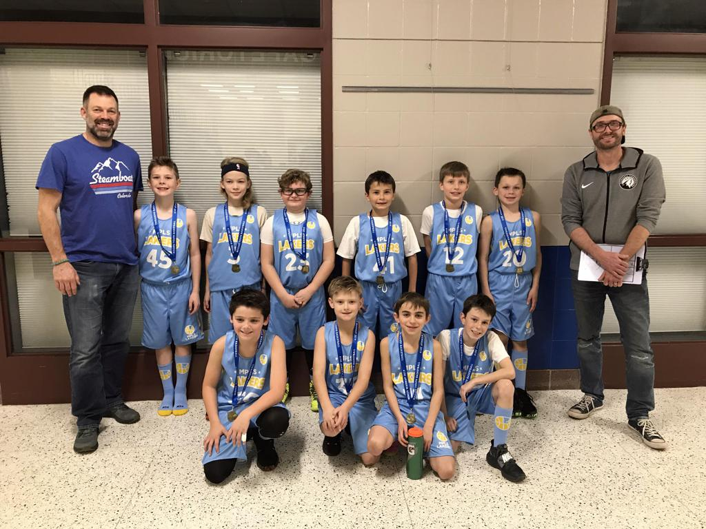 Minneapolis LakersBoys 4th Grade Blue pose with their medals after earning 2nd place at the Rogers Winter Warmup tournament in Rogers, MN
