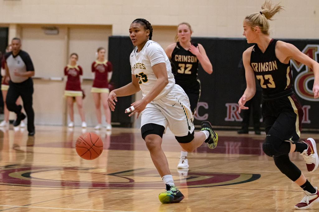 Park Center's Adalia McKenzie (25) brings the ball up the court against host Maple Grove Tuesday night. McKenzie scored 30 points as the Pirates defeated the Crimson 69-65. Photo by Gary Mukai, SportsEngine