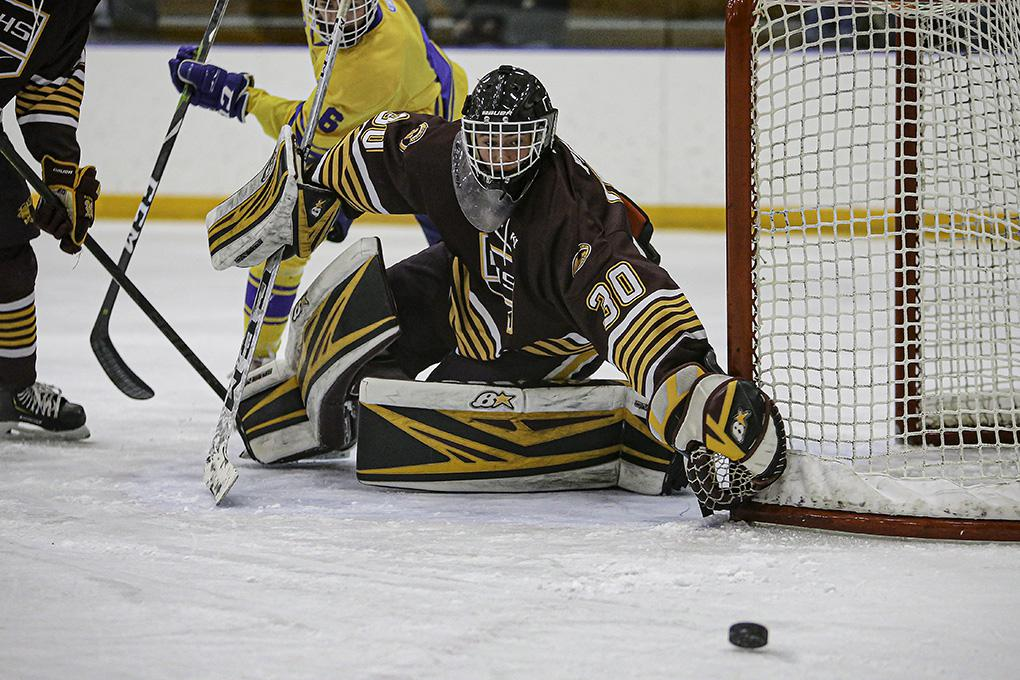 Northfield goal Cal Frank (30) knocked away a second-period shot by Hastings' Kyle Bauer (6). Photo by Mark Hvidsten, SportsEngine