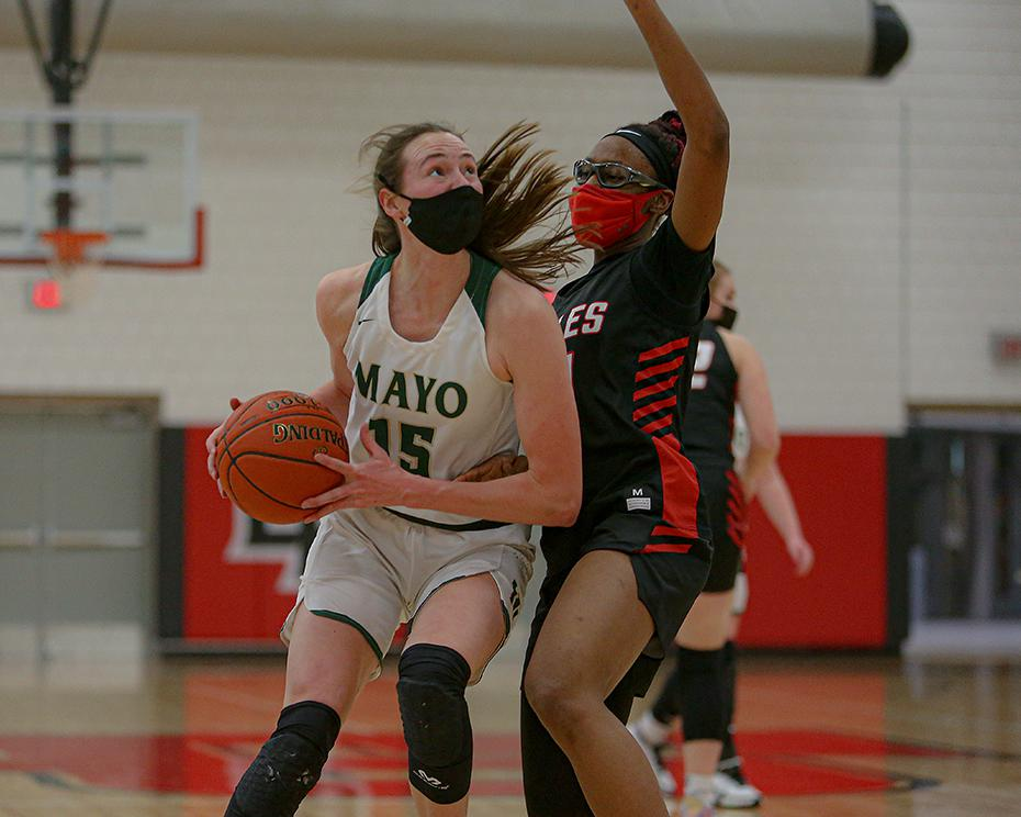 Anna Miller makes a move on Eden Prairie defender Nia Holloway in the first half. Miller scored a game-high 22 points for the Spartans. Photo by Mark Hvidsten, SportsEngine