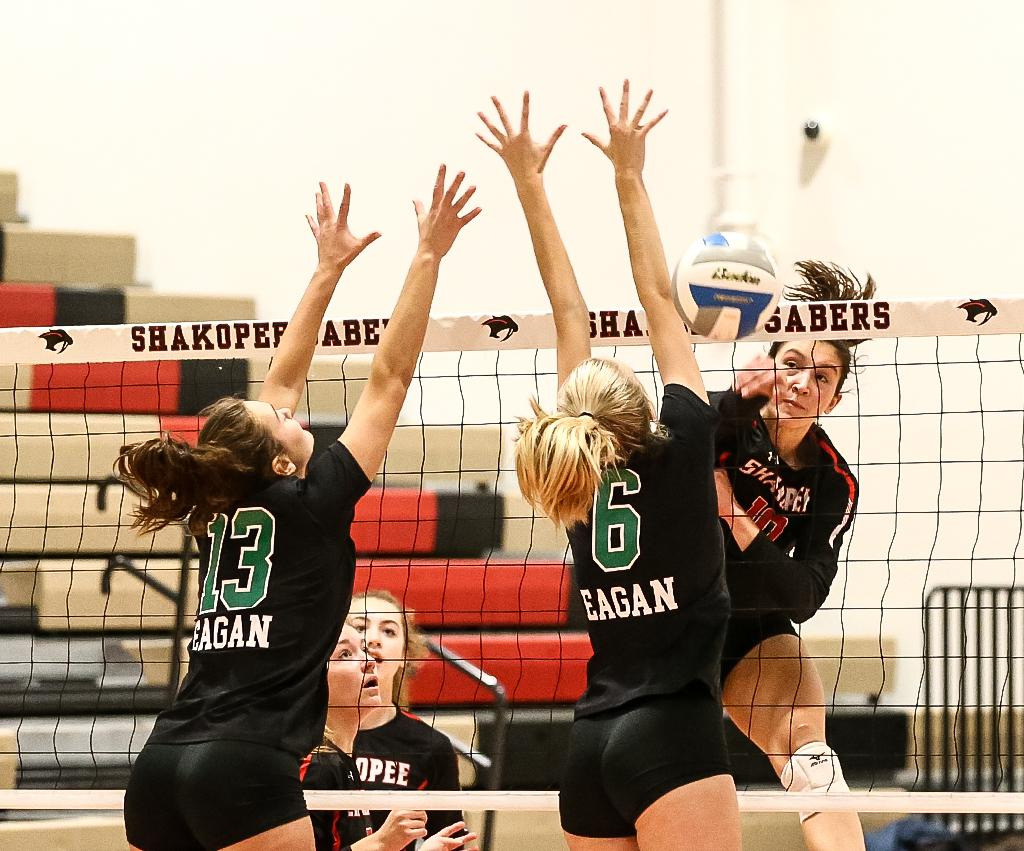 Ary Forsberg (10) sends the fall flying past Abby Moe (6). Forsberg helped lead Shakopee to a five-set win over Eagan for the first time since 2015. Photo by Cheryl A. Myers, SportsEngine