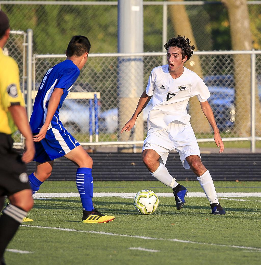 East Ridge junior Cameron Kor (17) had a goal and an assist on Tuesday night. Kor and the Raptors ended a nine game winning streak for the Royals in the Suburban East Conference matchup. Photo by Cheryl A. Myers, SportsEngine