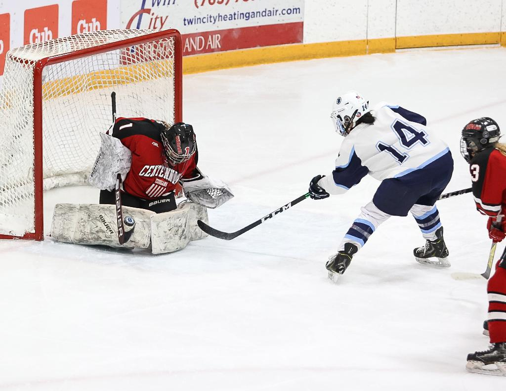 Freshman goaltender Kaitlin Groess (1) stops the puck on a scoring chance by Grace Bautch (14) in the second period. Groess tallied a shutout over Northwest Suburban Conference rival Blaine at Fogerty Arena on Tuesday night. Photo by Cheryl A. Myer