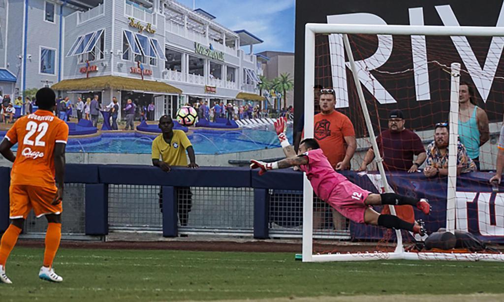 Fabian Cerda dives to save a shot during Tuesday's match.  (Matt Christensen)