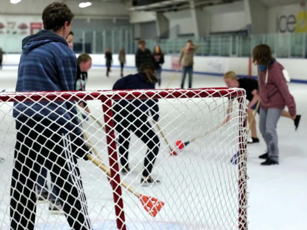 Broomball players on the ice