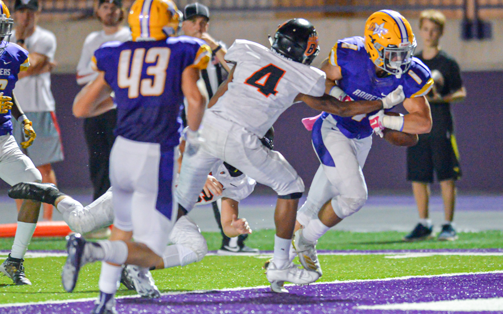 Raiders senior running back Tony Underwood rushes in for a touchdown early in the first quarter at the University of St. Thomas Friday night. The Raiders went on to beat the Bears 28-13. Photo by Earl J. Ebensteiner, SportsEngine