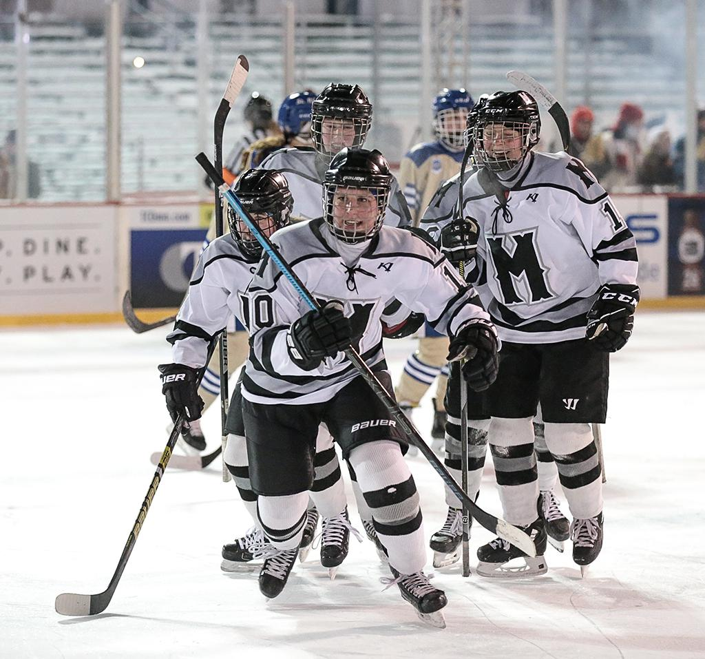 Julia Stevens (10) heads to the bench to celebrate her goal with teammates. Stevens had a goal and an assist in Minneapolis' 3-2 overtime win over Holy Angels on Thursday night. Photo by Cheryl A. Myers, SportsEngine