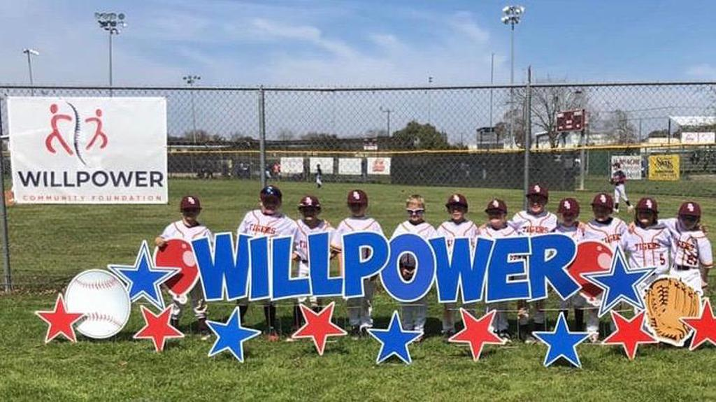 7U Tigers pose at the Will Power sign at DSYSA baseball complex