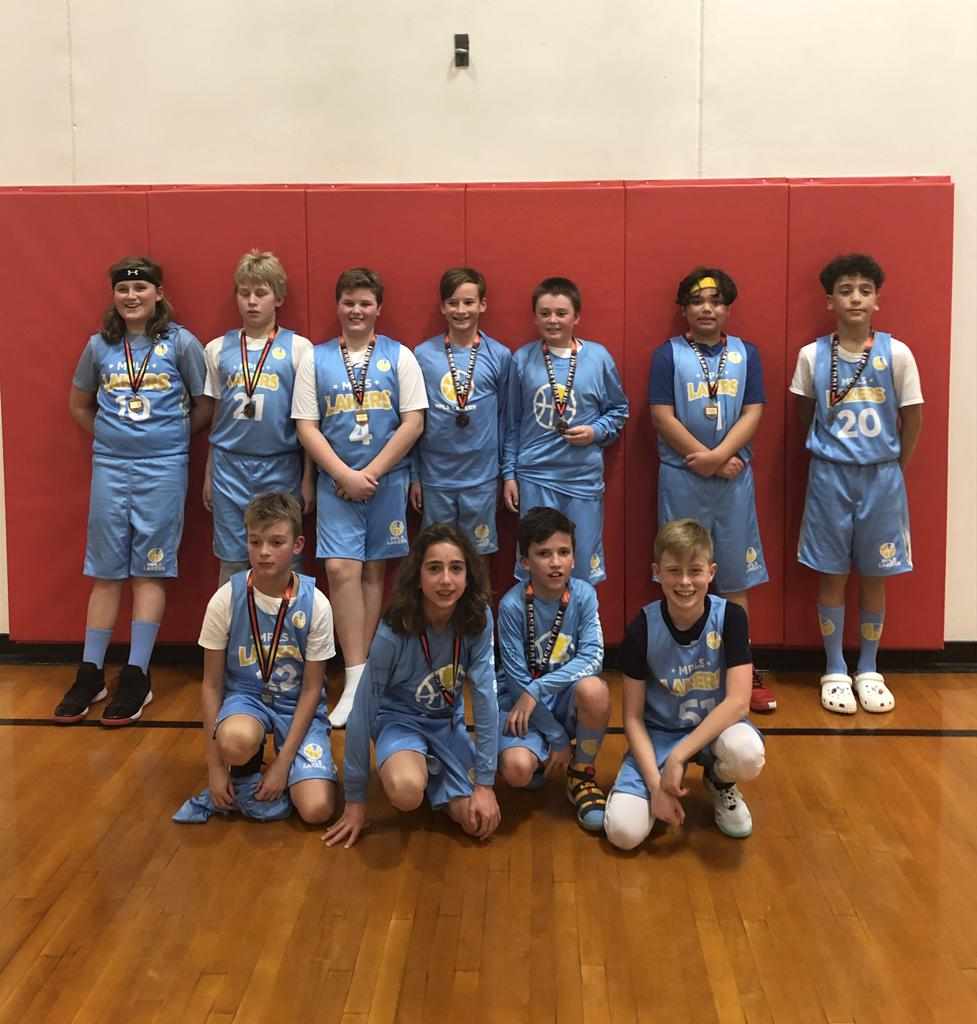 Mpls Lakers Youth Traveling Basketball Program Inc Boys 6th Grade White pose with their T-Shirts after becoming the Champions at the Inver Grove Heights tournament in Inver Grove Heights, MN