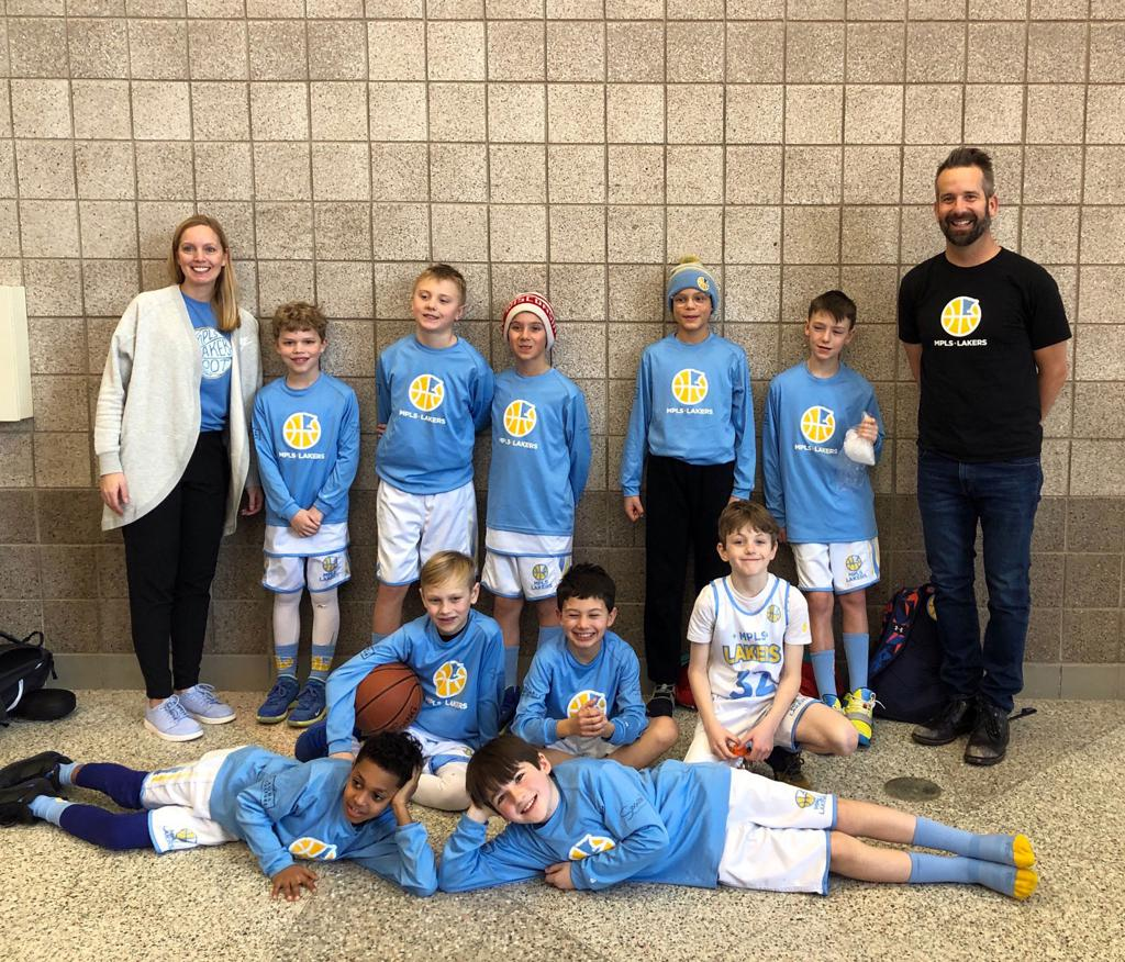 Minneapolis Lakers Boys 4th Grade Gold pose after becoming the Champions at Maple Grove Supersaver in Maple Grove, MN