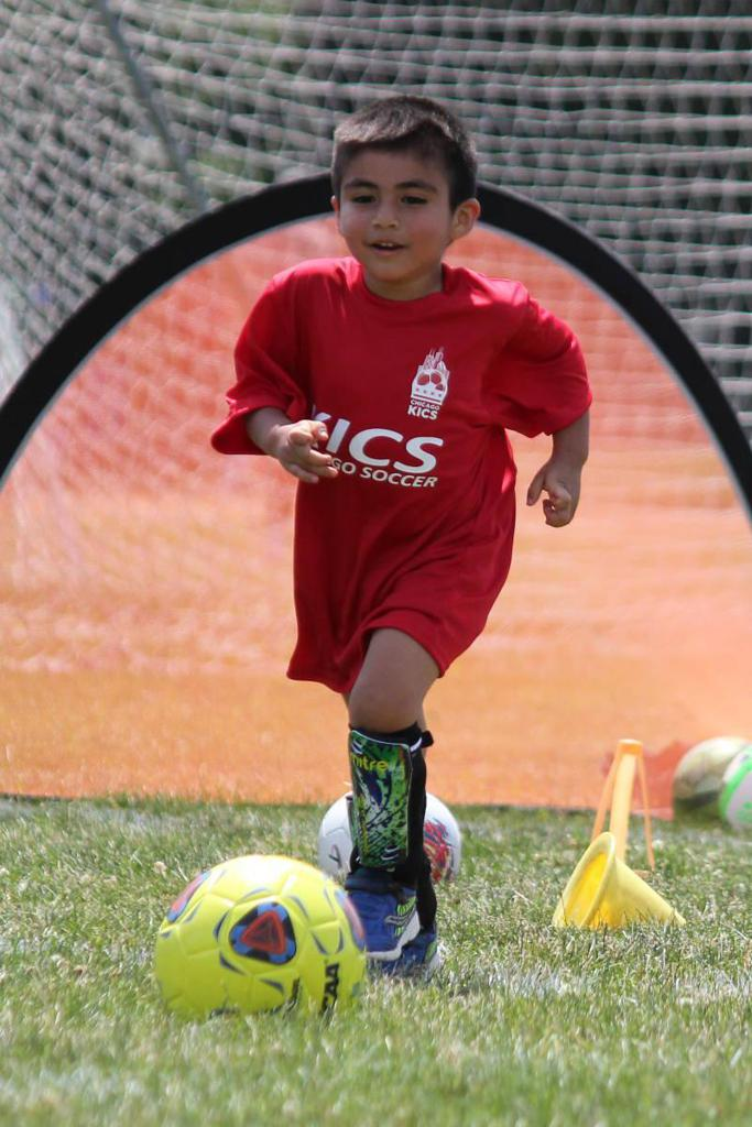toddlers player dribbling