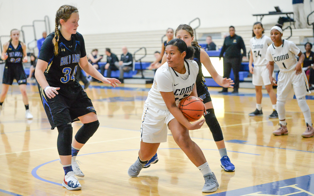 St. Paul Como Park freshman Jada James looks for an opening early in the game. The Cougars lost to the Stars Tuesday night 90-88. Photo by Earl J. Ebensteiner, SportsEngine