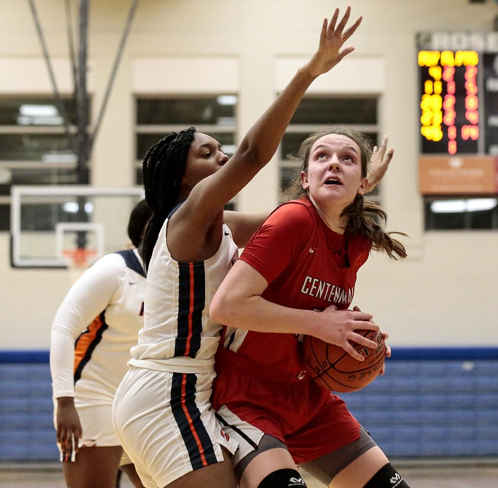 Centennial's Jenna Guyer (45) scored 14 points in the first half and finished with a game-high 18 points. The Cougars outscored the Hawks by 12 points in the second half for a 61-49 win at Roseville Area High School. Photo by Cheryl A. Myers, SportsEngine