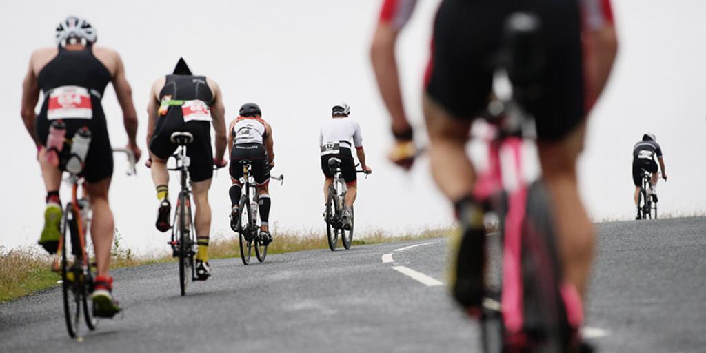 Triathletes biking