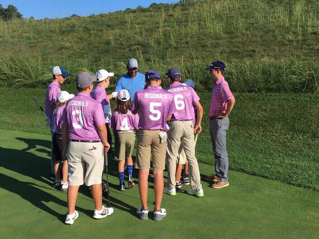 Captain Rich Jones, PGA, huddles with the Suffolk County 2 All-Stars before their final round.