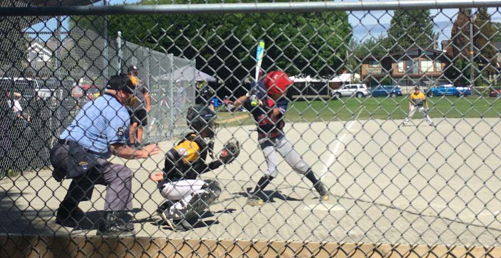 Umpire with player at bat