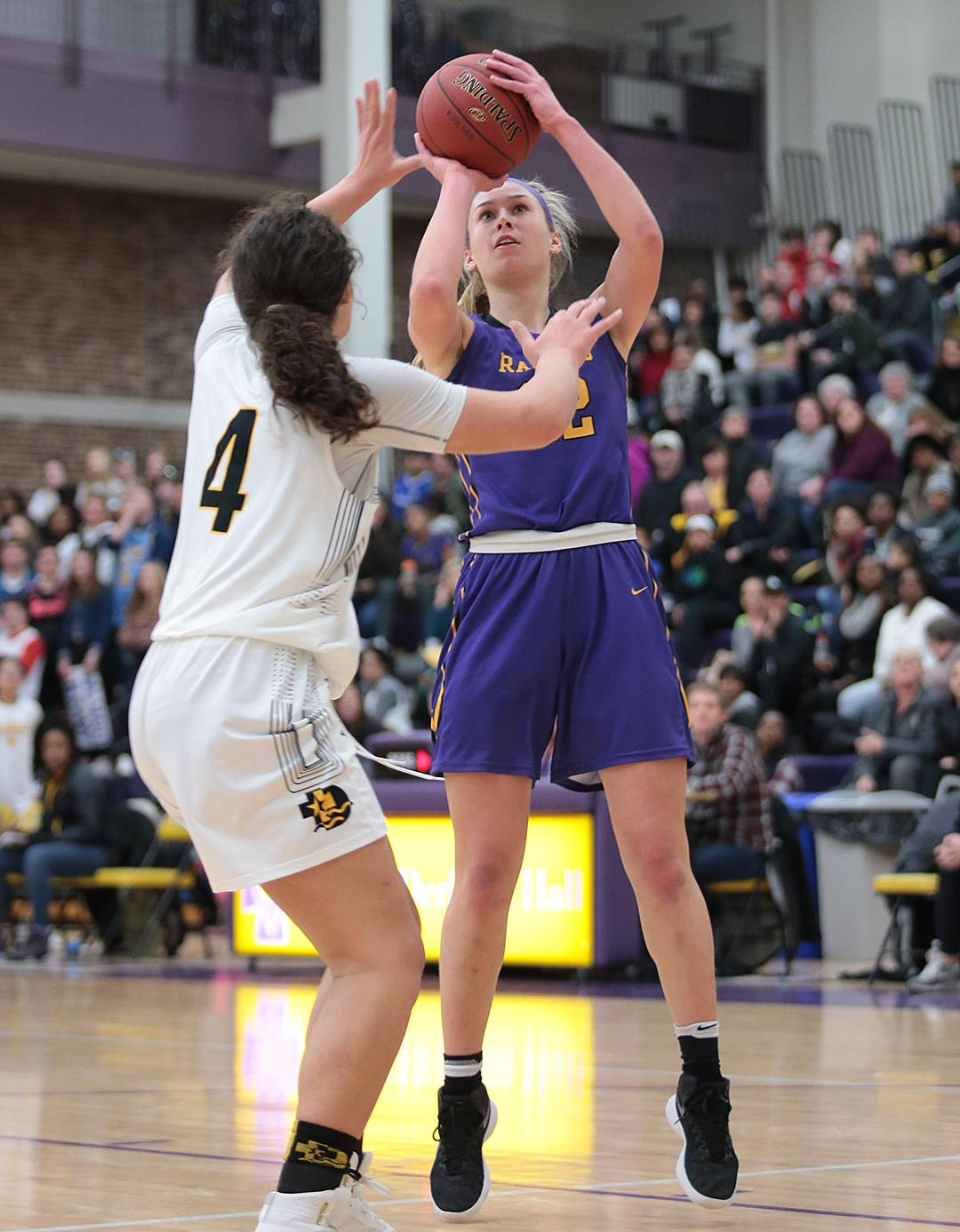 Junior forward Frannie Hottinger (22) goes over defender Olivia Travis (4) for another two points. Hottinger led Creitin-Derham Hall to a 62-50 victory with a game high 20 points. Photo by Cheryl Myers, SportsEngine