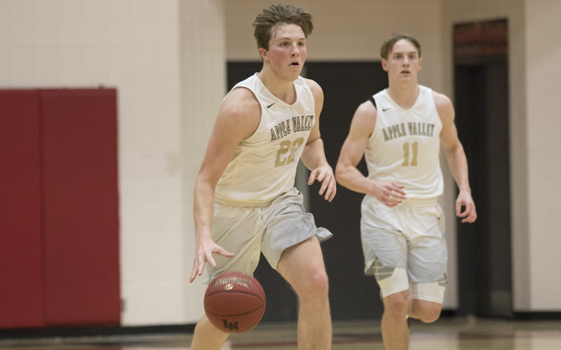 Apple Valley guard Zach Korba brings the ball up the court against Lakeville North. The Eagles defeated the Panthers 63-50 Tuesday night in Lakeville. Photo by Jeff Lawler, SportsEngine
