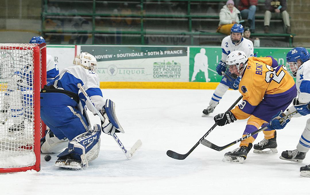 Ethan Benz (9) sends a shot through the legs of Minnetonka goaltender Charlie Glockner (1) for Chaska's only goal of the afternoon. Photo by Cheryl Myers, SportsEngine
