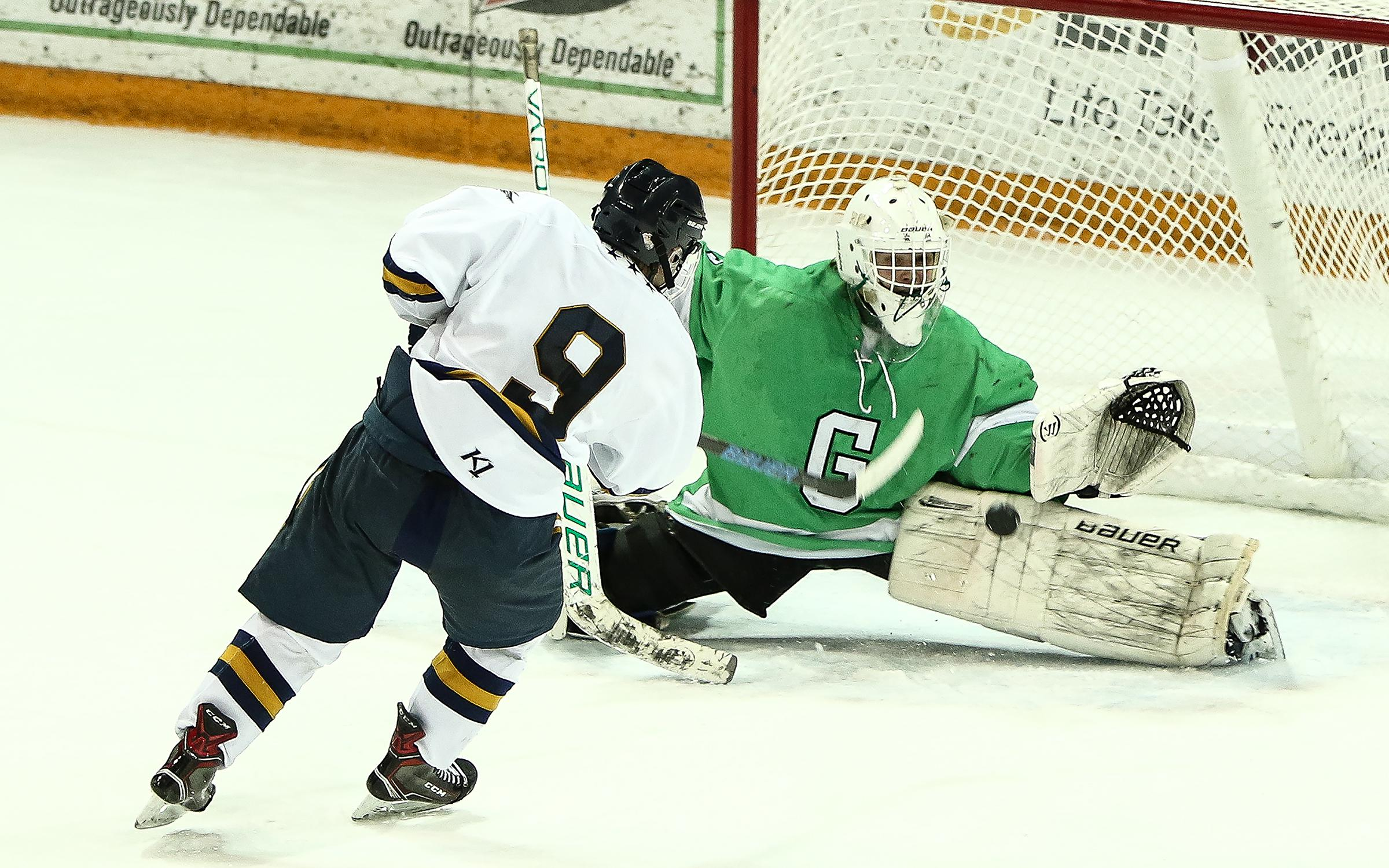 Greenway sophomore goaltender Ville Hyttinen robs Hermantown's Brady Baker in the slot late in the first overtime in the Class 1A, Section 7 championship game at AMSOIL Arena. Photo by Dave Harwig, Viewthroughmylens.net