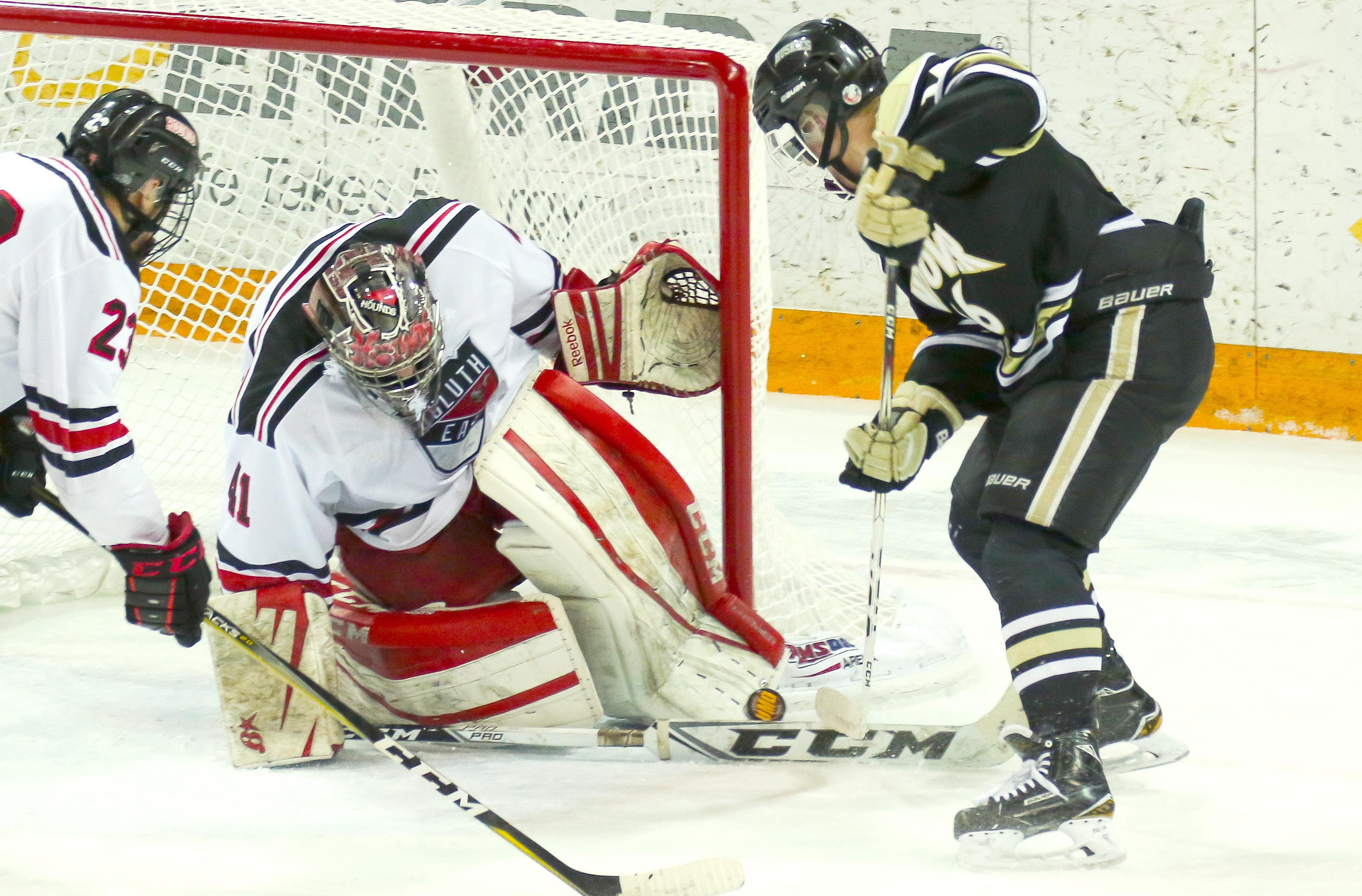 Duluth East goaltender Parker Kleive stops a shot by Andover's Holden Dunleavy during Thursday's Class 2A, Section 7 championship game at AMSOIL Arena. The 'Hounds defeated the Huskies 3-2 in overtime. Photo by Dave Harwig, Viewthroughmylens.net