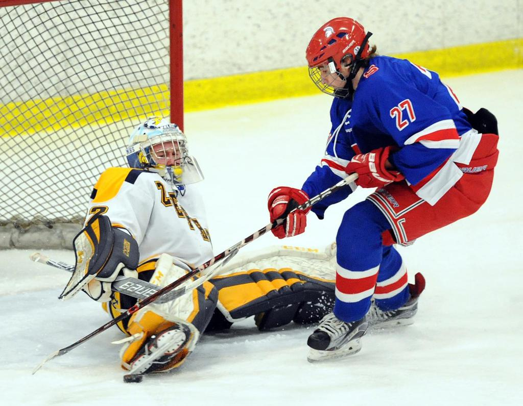 Mahtomedi goaltender Bailey Huber stops a scoring attempt by Simley's Trent Peterson during Friday's Class 1A, Section 4 championship. Photo by Loren Nelson, SportsEngine