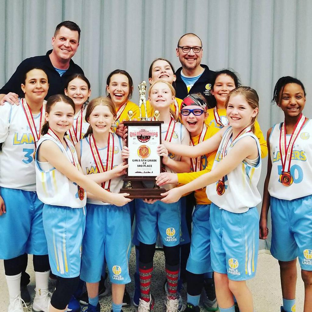 Girls 5th Grade Gold take 3rd Place at State, pose with huge trophy