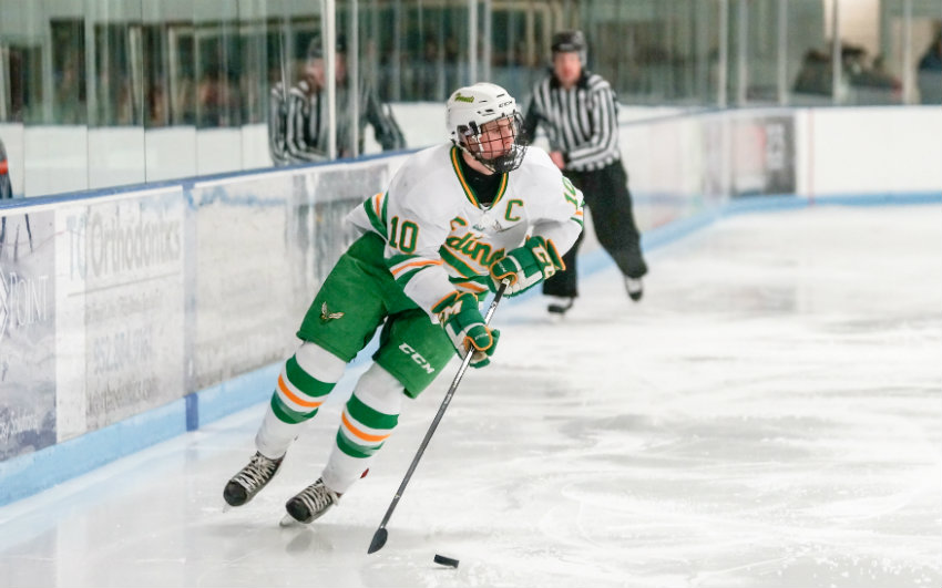 Edina's Sammy Walker moves the puck up the ice against St. Louis Park in the Class 2A, Section 6 semifinals on Feb. 24. Photo by Korey McDermott, SportsEngine