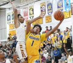 Woodbury junior Aaron Estrada drives to the first half of Woodbury's 62-53 win in the South Jersey Group 1 Final