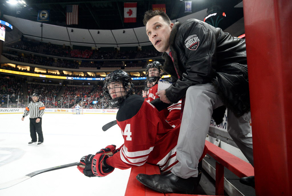 Centennial coach Ted Cheesebrough sports his custom Hockey Day Minnesota  jacket during the state Class 2A semifinals. Photo by AARON LAVINSKY 1d99dc8bb