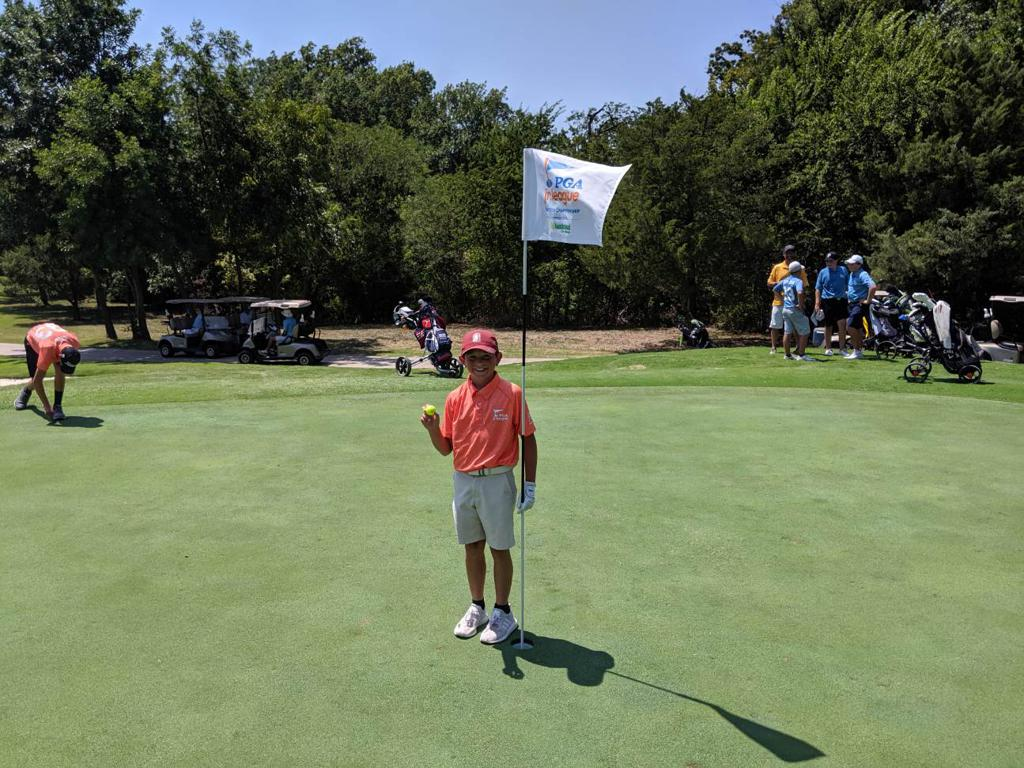 Alex Escamilla, 10, made his hole-in-one during the final match of the Northern Texas Section Championship at Firewheel Golf Park from 90 yards out!
