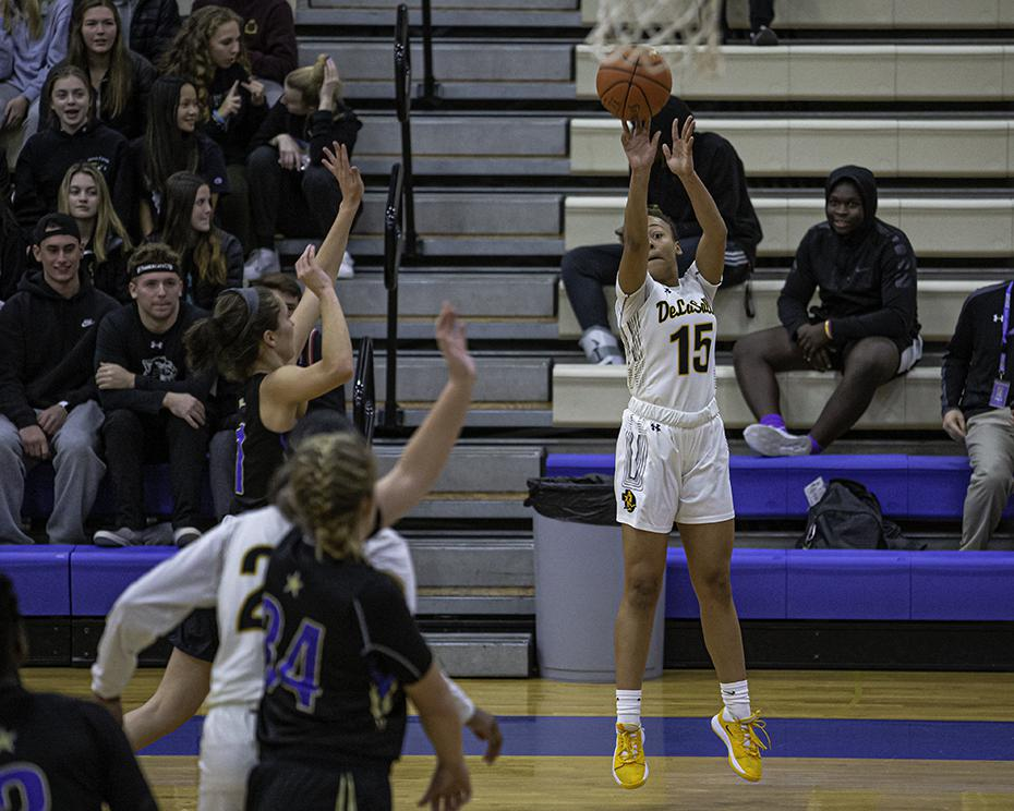 The three-point shooting of Sydney Runsewe (15) set the pace for DeLaSalle in the first half. She scored 15 of her 26 points in the game's first 18 minutes. Photo by Mark Hvidsten, SportsEngine