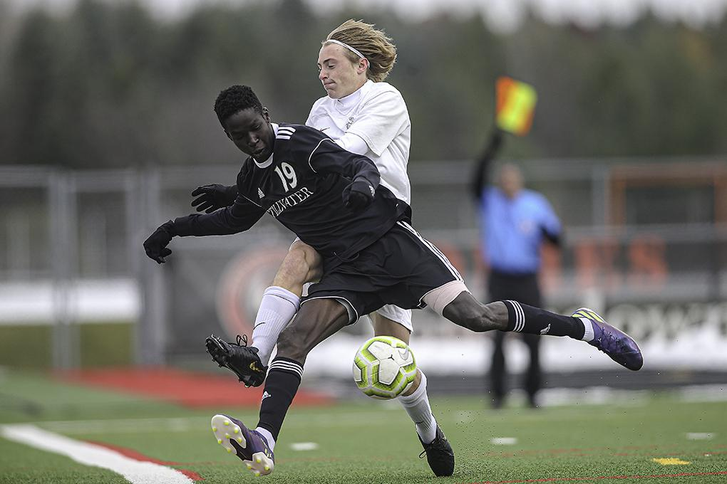 Stillwater's Gora Gora (19) collides with Park of Cottage Grove's Lucas Bollback in the second half. Gora assisted on the game's only goal. Photo by Mark Hvidsten, SportsEngine
