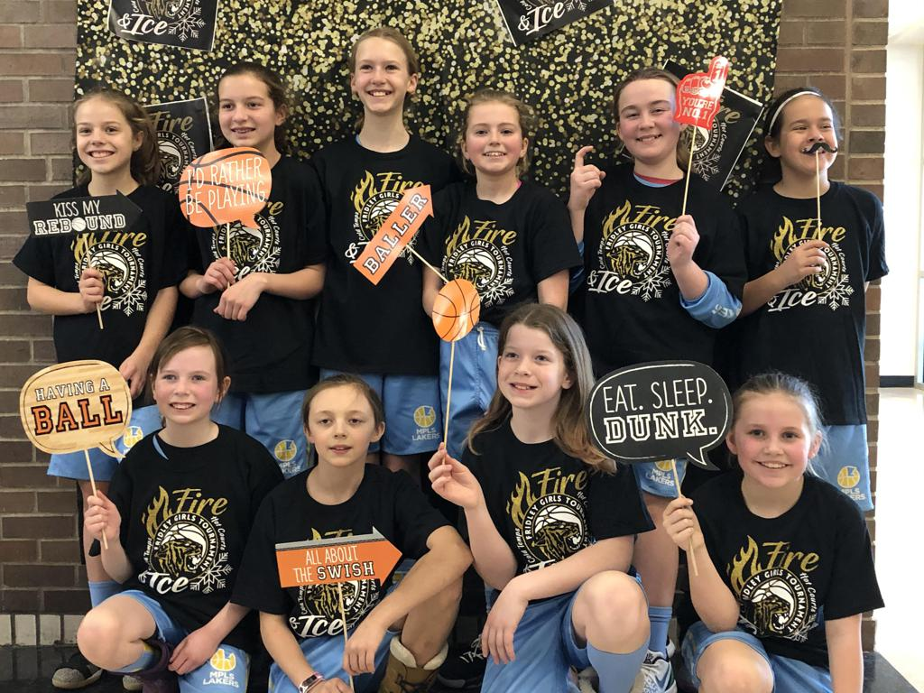 Mpls Lakers Youth Traveling Basketball Program Inc Girls 5th Grade Blue pose with their T-Shirts after taking Third Place at the Fridley Fire & Ice tournament in Fridley, MN