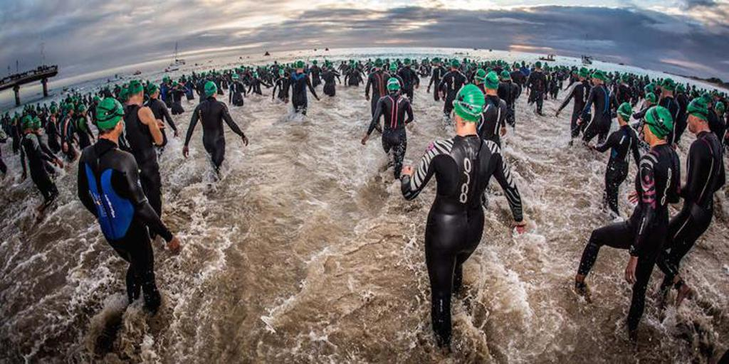 Triathletes entering the water
