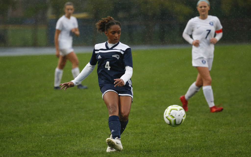 Champlin Park's Maille Mathis (4) advances the ball against Blaine Tuesday evening. Mathis had a goal and an assist in the Rebels' 3-0 victory over the Bengals at Champlin Park High School. Photo by Jeff Lawler, SportsEngine