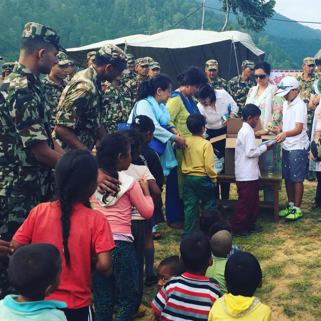 Jaivir assists his family with relief work in Nepal following the 2015 earthquake.