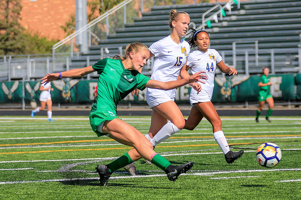 Edina's Maddie Dahlien (5) outraced St. Michael-Albertville defenders Abby Buckmeier (15) and Rheana Zerna to score on this first-half shot. Photo by Mark Hvidsten, SportsEngine